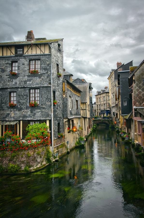 The half-timbered houses along the canals of Pont Audemar survived the Battle of Normandy. Credit: Óðinn Árnason on Fivehundredpx