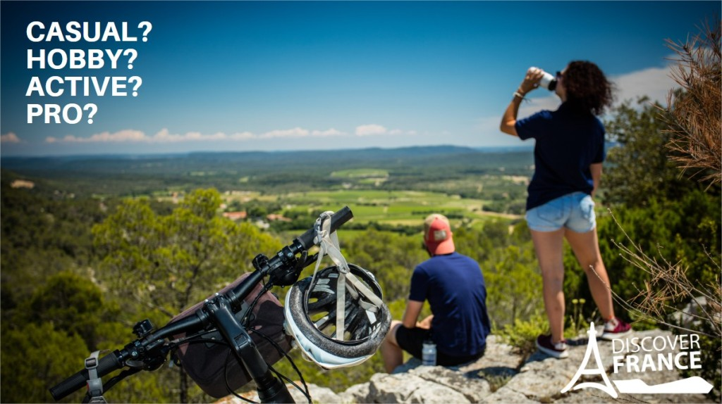 Couple overlooking a valley in France during a cycling trip